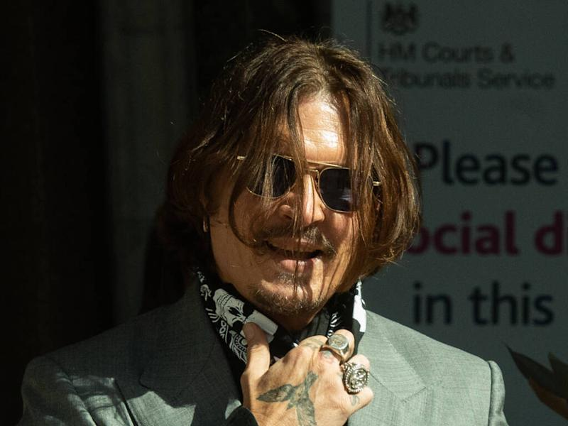 Johnny Depp gives gifts to fans outside court on last day of libel trial