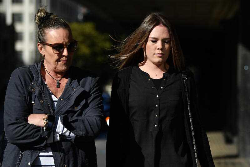 Monica Elizabeth Young (right) arrives at the Downing Centre District Court in Sydney.