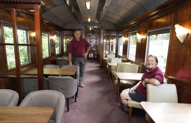 Simon and Diana Parums inside their full-size steam train with carriages, tracks and platform as they converted and restored Bassenthwaite Lake station in Keswick