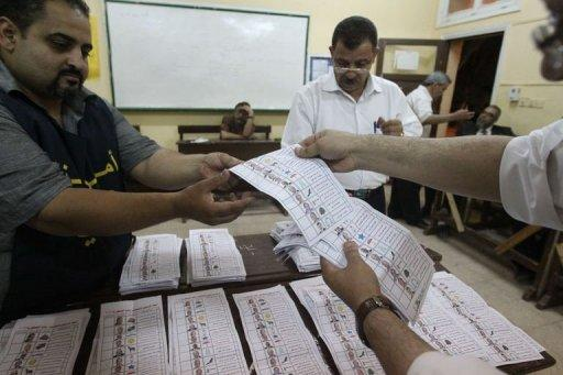Egyptian election officials count ballots at a polling station in Cairo