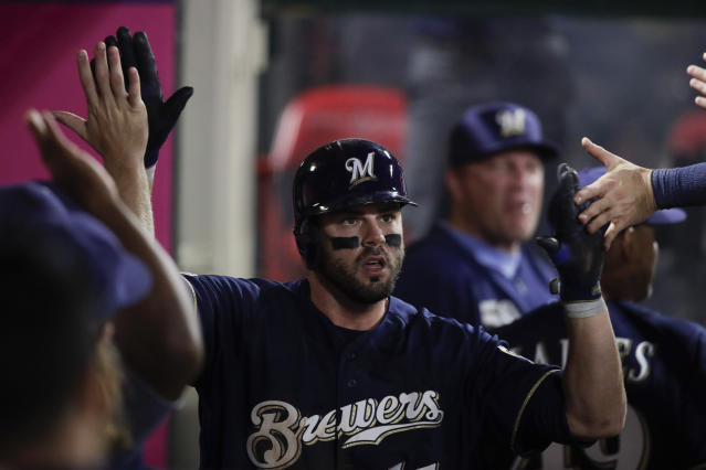 Milwaukee Brewers' Mike Moustakas celebrates his home run in the dugout during the fourth inning of a baseball game against the Los Angeles Angels, Monday, April 8, 2019, in Anaheim, Calif. (AP Photo/Jae C. Hong)
