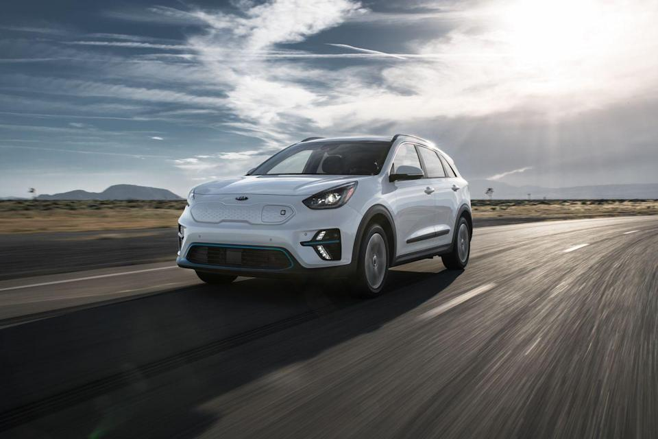 """<p>We were able to shove 19 carry-on suitcases in the <a href=""""https://www.caranddriver.com/kia/niro-ev"""" rel=""""nofollow noopener"""" target=""""_blank"""" data-ylk=""""slk:Kia Niro EV"""" class=""""link rapid-noclick-resp"""">Kia Niro EV</a>, one more than the <a href=""""https://www.caranddriver.com/kia/niro"""" rel=""""nofollow noopener"""" target=""""_blank"""" data-ylk=""""slk:hybrid Niro"""" class=""""link rapid-noclick-resp"""">hybrid Niro</a>, and two more than the PHEV model. Thank the lower floor that allows more space between the folded seats and the roof. The electric Niro only gets an EPA-estimated 239 miles on a single charge, so don't forget to pack your charging cord.</p><ul><li>Base price: $40,265</li><li>Carry-on capacity, rear seats folded: 19 suitcases</li><li>Cargo volume, rear seats folded: 53 cubic feet<br></li><li>Cargo volume, behind rearmost row of seats: 18 cubic feet<br></li></ul><p><a class=""""link rapid-noclick-resp"""" href=""""https://www.caranddriver.com/kia/niro-ev/specs"""" rel=""""nofollow noopener"""" target=""""_blank"""" data-ylk=""""slk:MORE NIRO EV SPECS"""">MORE NIRO EV SPECS</a></p>"""