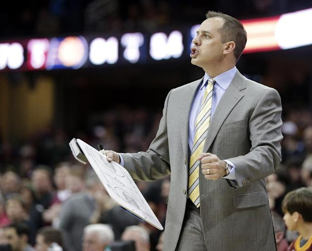 Indiana Pacers head coach Frank Vogel reacts in the fourth quarter of an NBA basketball game against the Cleveland Cavaliers, Sunday, Jan. 5, 2014, in Cleveland. The Pacers won 82-78. (AP Photo/Tony Dejak)