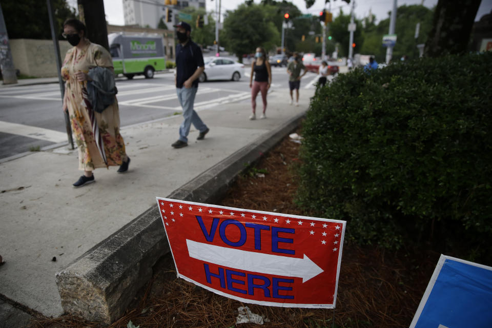 People wait in a line to vote in the Georgia's primary election at Park Tavern on Tuesday, June 9, 2020, in Atlanta. (AP Photo/Brynn Anderson)