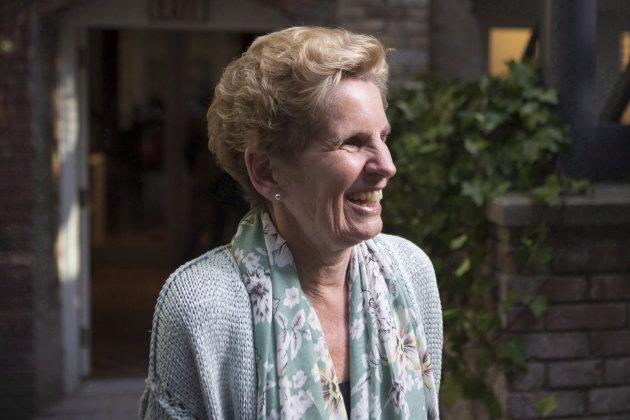 Former Ontario premier Kathleen Wynne visits a daycare in Toronto on May 18, 2018.