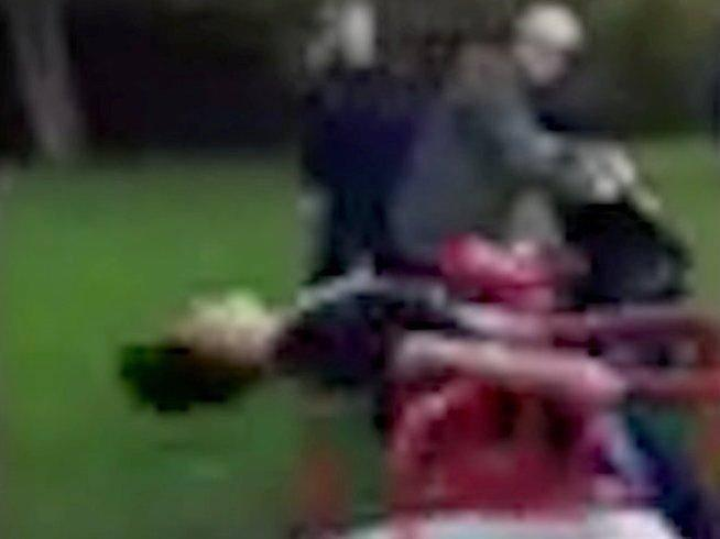 Still from video showing the 11-year-old being spun on a roundabout at high speed (Screengrab)