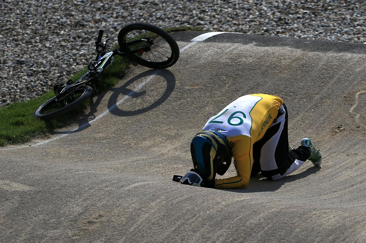 LONDON, ENGLAND - AUGUST 09: Khalen Young of Australia lies on the ground after crashing during the Men's BMX Cycling Quarter Finals on Day 13 of the London 2012 Olympic Games at BMX Track on August 9, 2012 in London, England.  (Photo by Phil Walter/Getty Images)