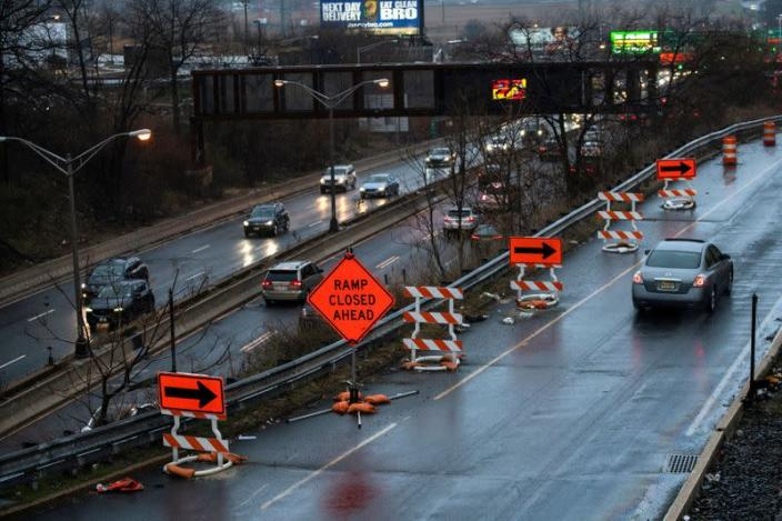FILE PHOTO: Cars drive along the NJ 495 route while road work signs are seen on the roadside, in Union City