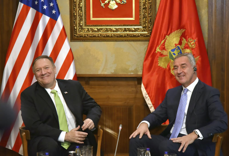 In this photo taken Friday, Oct. 4, 2019, United States Secretary of State Mike Pompeo, left, speaks with Montenegro President Milo Djukanovic, in Podgorica, Montenegro. Deployed inside the sprawling communist-era army command headquarters in Montenegro's capital, a group of elite U.S. military cyber experts are plotting strategy in a fight against potential Russian and other cyberattacks ahead of the 2020 American and Montenegrin elections.  (AP Photo/Risto Bozovic)