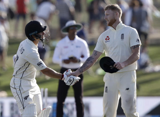 New Zealand's BJ Watling, left, is congratulated by England's Ben Stokes as he leaves the field 119 not out at the close of play on day three of the first cricket test between England and New Zealand at Bay Oval in Mount Maunganui, New Zealand, Saturday, Nov. 23, 2019. (AP Photo/Mark Baker)