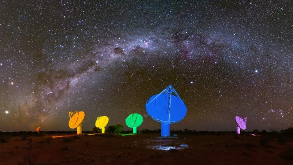 Six of the Australian Square Kilometre Array Pathfinder's (ASKAP) antennas, which are illuminated with colours of rainbow ahead of Mardi Gras last year. Source: AAP