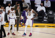 Los Angeles Lakers forward LeBron James (23) tries to shake off an injury during the first half of an NBA basketball game against the Atlanta Hawks Saturday, March 20, 2021, in Los Angeles. (AP Photo/Marcio Jose Sanchez)