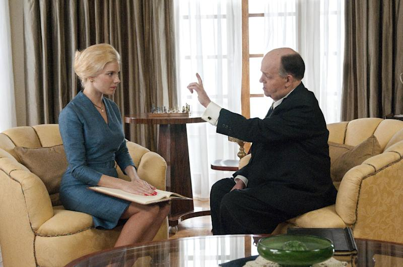 """This image released by HBO shows Toby Jones, portraying Alfred Hitchcock, right, with Sienna Miller, portraying Tippi Hedren, in a scene from the film """"The Girl,"""" premiering Saturday, Oct. 20, 2012 at 9 p.m. EST. The HBO movie dramatizes the making of Hitchcock's """"The Birds"""" and his relationship with Hedren. (AP Photo/HBO, Kelly Walsh)"""