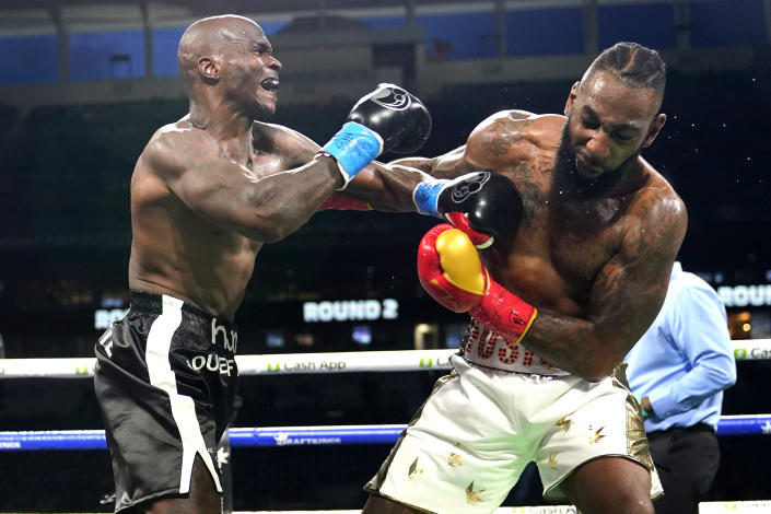 Former NFL wide receiver Chad Johnson, left fights Brian Maxwell during an exhibition boxing match at Hard Rock Stadium, Sunday, June 6, 2021, in Miami Gardens, Fla. (AP Photo/Lynne Sladky)