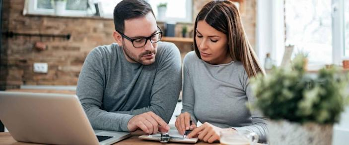 Couple doing finances at home.