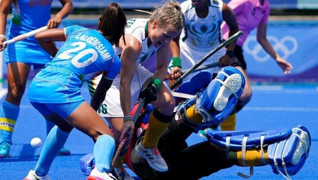 South Africa's Erin Hunter vies for the ball with India's Lalremsiami in the women's hockey Pool A clash, which the Indians won 4-3. AP