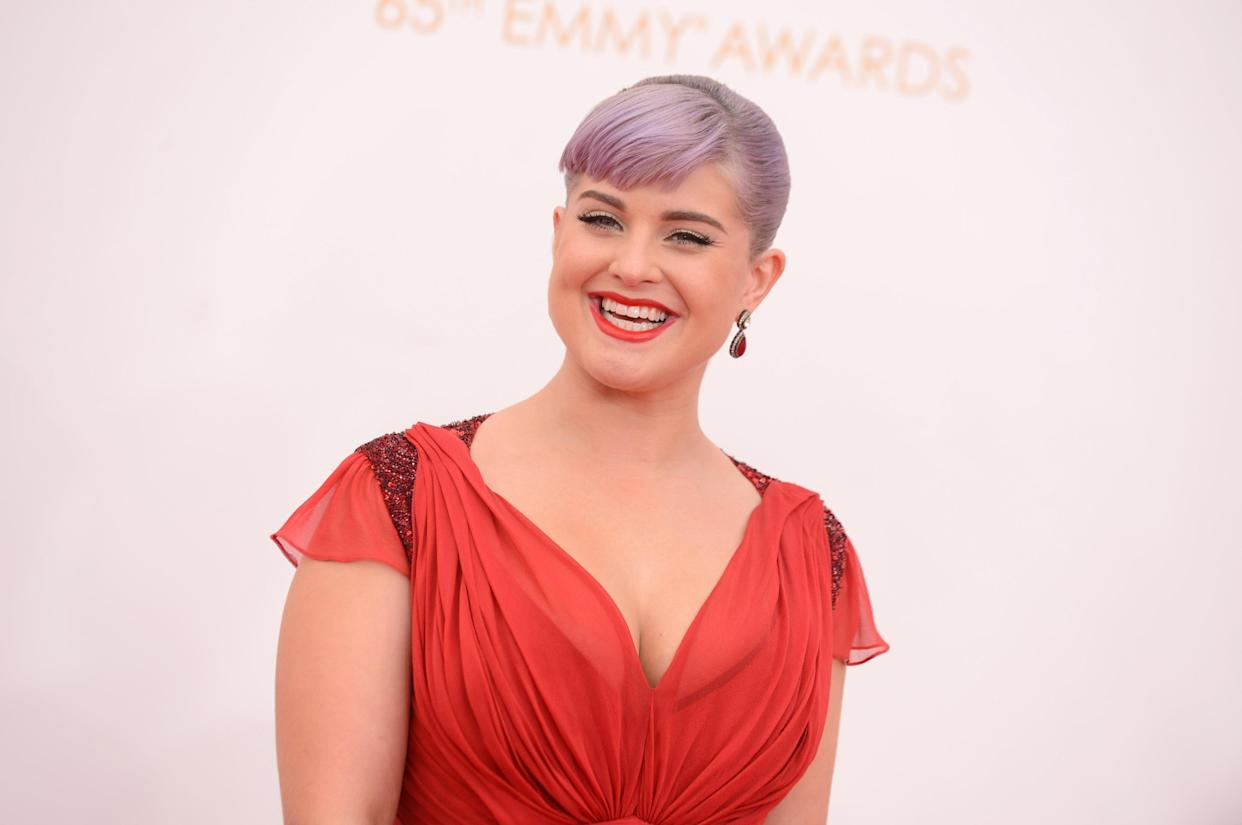 Kelly Osbourne arrives at the 65th Primetime Emmy Awards at Nokia Theatre on Sunday Sept. 22, 2013, in Los Angeles.  (Photo by Jordan Strauss/Invision/AP)