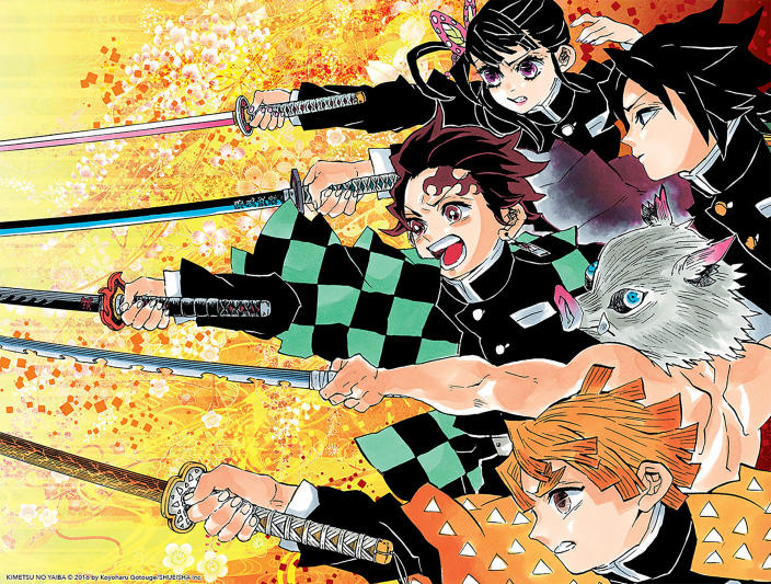"This image released by KIMETSU NO YAIBA©2016 by Koyoharu Gotouge/SHUEISHA Inc. shows a scene of the manga book ""Demon Slayer."" ""Demon Slayer,"" directed by Haruo Sotozaki, has become the biggest grossing film for Japan, including live-action films, and has struck a chord with pandemic-era Japan, and possibly with the world. (KIMETSU NO YAIBA©2016 by Koyoharu Gotouge/SHUEISHA Inc. via AP)"
