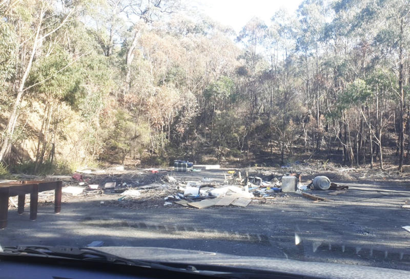 Pictured is the waste scattered across an area surrounded by bushland in Colo Vale.