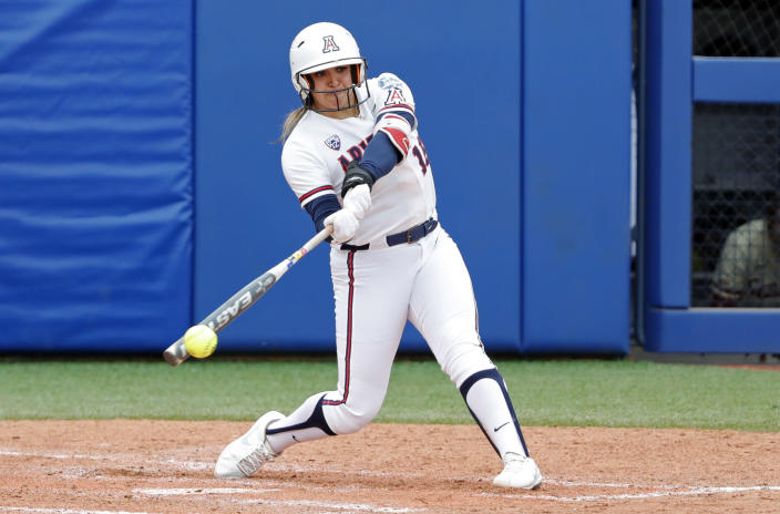 Arizona's Sharlize Palacios (18) gets a hit in the fifth inning of an NCAA Women's College World Series softball game against Florida State, Saturday, June 5, 2021, in Oklahoma City. (AP Photo/Alonzo Adams)