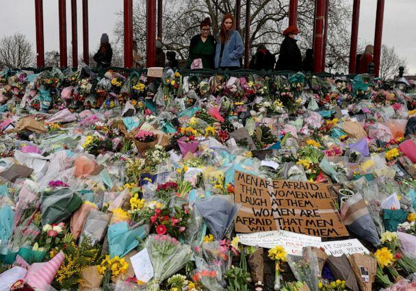 PHOTO: People look at the floral tributes placed in tribute to Sarah Everard on Clapham Common, on March 15, 2021, in London. (Dan Kitwood/Getty Images)