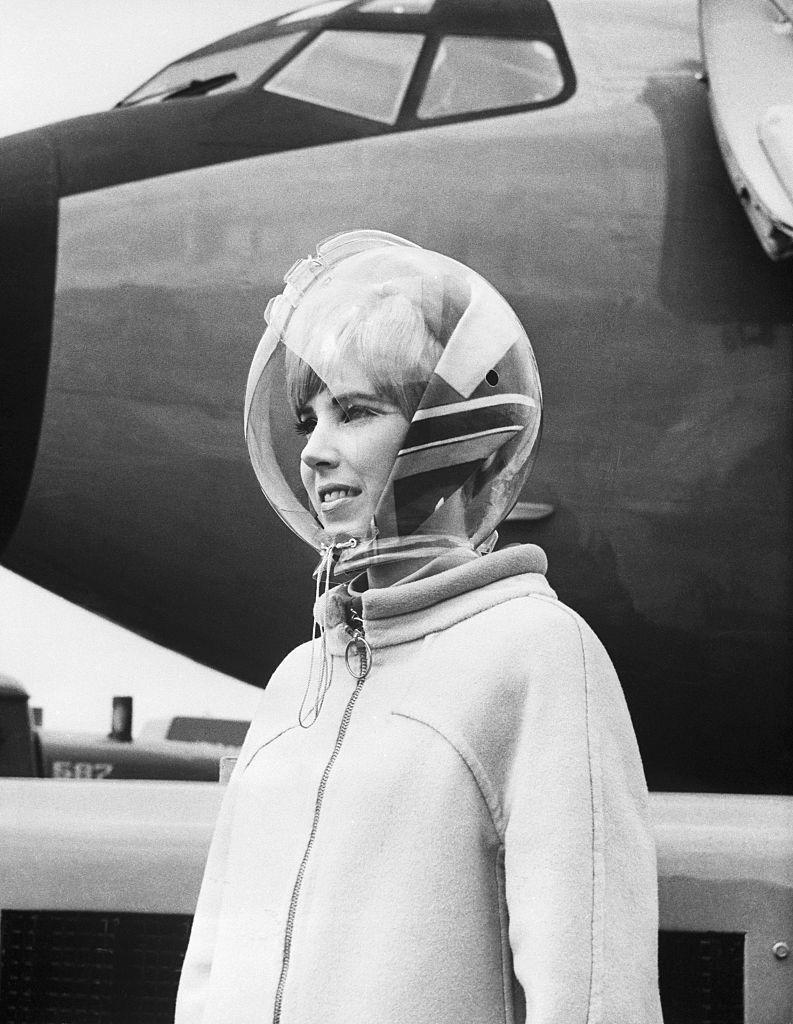 "<p>Some uniforms were more avant-garde than others. This uniform, designed by Emilio Pucci for Braniff International Airways in 1965, was complete with a space-like helmet of transparent plastic.<a href=""https://airandspace.si.edu/multimedia-gallery/web10777-2007hjpg"" rel=""nofollow noopener"" target=""_blank"" data-ylk=""slk:The helmet"" class=""link rapid-noclick-resp""> The helmet</a> was designed to shield the flight attendants from wind and rain on the tarmac, according to the Smithsonian National Air and Space Museum. </p>"