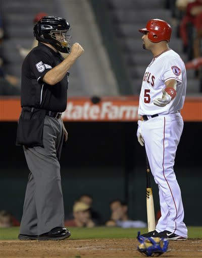 Los Angeles Angels' Albert Pujols complains to home plate umpire Bill Welke after striking out during the inning fourth of a baseball game against the Texas Rangers, Thursday, Sept. 20, 2012, in Anaheim, Calif. (AP Photo/Mark J. Terrill)