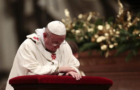 Pope Francis prays during the Christmas night mass in the Saint Peter's Basilica at the Vatican