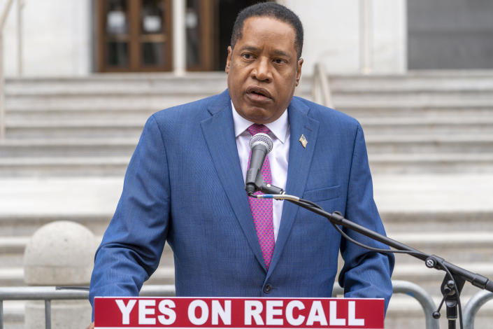 Conservative radio talk show host Larry Elder speaks to supporters during a campaign stop outside the Hall of Justice downtown Los Angeles Thursday, Sept. 2, 2021. Elder is running to replace Democratic Gov. Gavin Newsom in the Sept. 14 recall election. Democrats have an early edge in the California recall election that could remove Democratic Gov. Gavin Newsom from office. State figures show Democrats are returning mail-in ballots at more than twice the rate submitted by Republicans. (AP Photo/Damian Dovarganes)