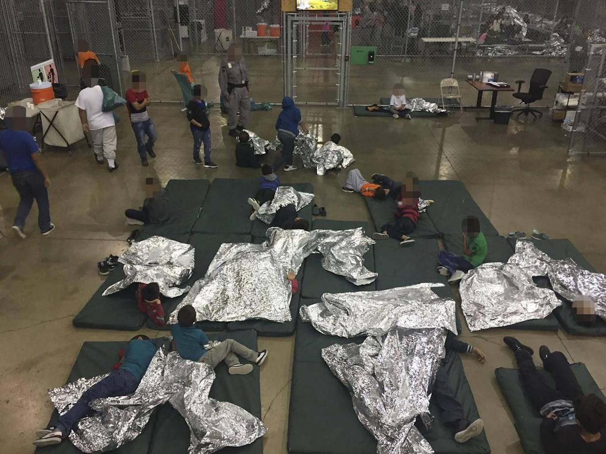 Intake of illegal border crossers by US Border Patrol agents (AFP/Getty/US Customs and Border Protection)