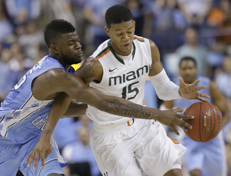 North Carolina's Marcus Paige, left, and Miami's Rion Brown, right, chase a loose ball during the second half of an NCAA college basketball game in the championship of the Atlantic Coast Conference tournament in Greensboro, N.C., Sunday, March 17, 2013. (AP Photo/Gerry Broome)