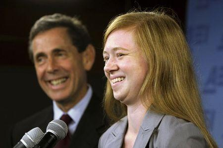 Abigail Fisher (R), a white suburban Houston student who asserted she was wrongly rejected by the University of Texas at Austin while minority students with similar grades and test scores were admitted thanks to the admissions policy, and Edward Blum (L), director of the Project on Fair Representation, smile at a news conference in Washington in this June 24, 2013 file photo. REUTERS/Jonathan Ernst/Files