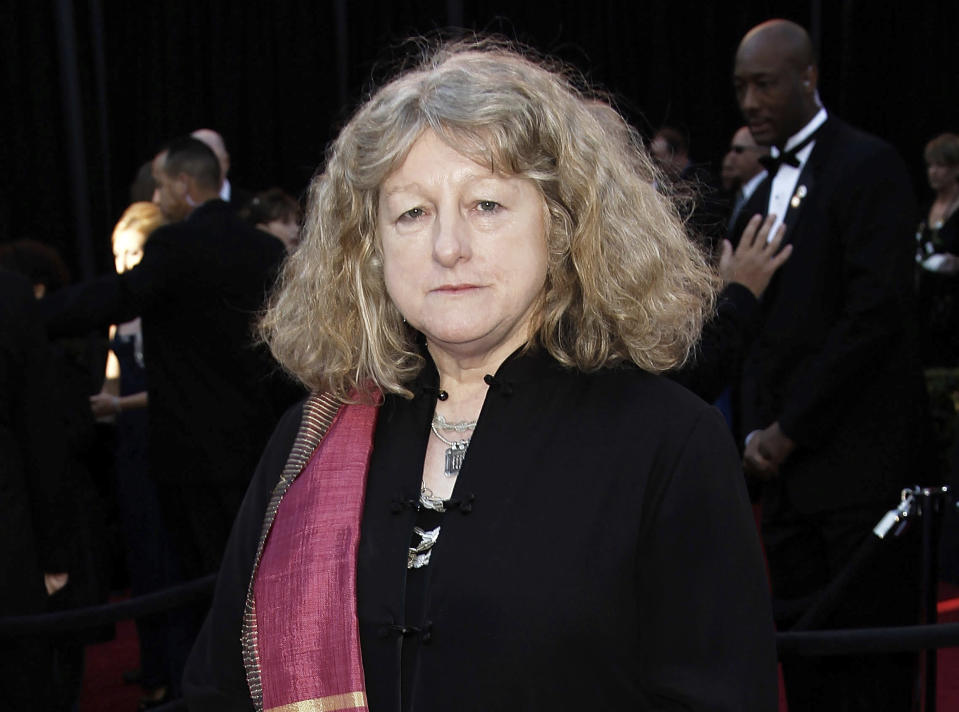 """FILE - In this Feb. 27, 2011 file photo, costume designer Jenny Beavan arrives at the 83rd Academy Awards in the Hollywood section of Los Angeles. Beavan designed the costumes for the film """"Cruella."""" (AP Photo/Matt Sayles, File)"""