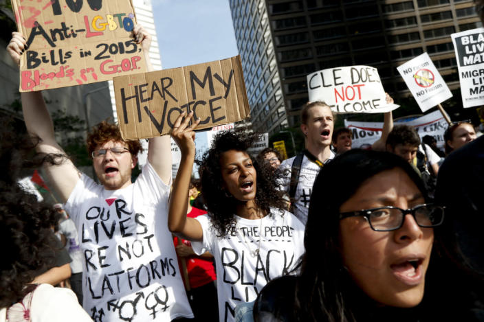 <p>Demonstrators take part in the Shut Down Trump and the RNC protest on Sunday, July 17, 2016, in Cleveland, Ohio. (Photo: John Minchillo/AP)</p>