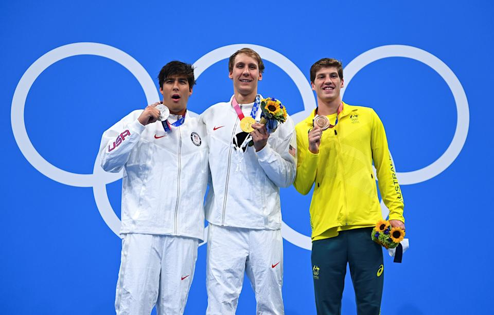 Gold medalist Chase Kalisz C of the United States, silver medalist Jay Litherland L of the United States and bronze medalist Brendon Smith of Australia stand on the podium during the awarding ceremony after the men's 400m individual medley final at the Tokyo 2020 Olympic Games in Tokyo, Japan, July 25, 2021. (Photo by Xu Chang/Xinhua via Getty Images)