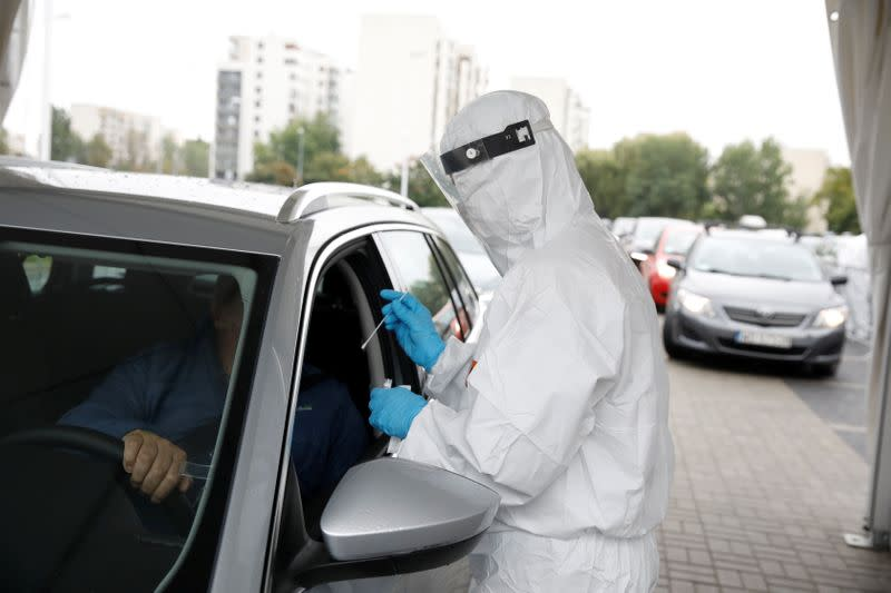 People are tested for the coronavirus disease (COVID-19) at a drive-thru testing centre in Warsaw