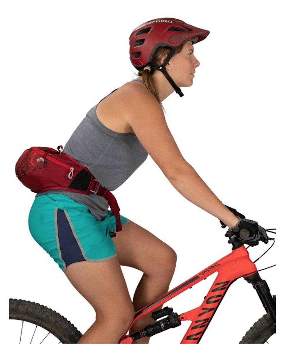 """<p>""""I just started mountain biking as a healthy activity I can do with my family and love wearing this <span>Osprey Savu 2 lumbar pack</span> ($50). It has room for a water bottle, snacks, keys, my phone, tissues, money, and a small first-aid kit - all the essentials. It's comfortable, lightweight, and I can also use it for a short hike, trail run, or road bike ride."""" - JS</p>"""