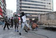 Demonstrators clash with security forces during a protest in Tripoli