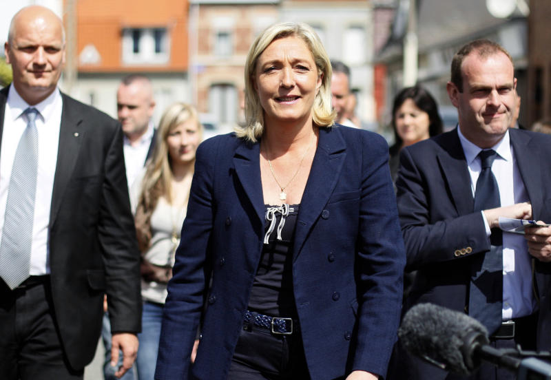 French far-right leader and National Front Party candidate for French legislative elections, Marine Le Pen is seen after voting for the second round, Sunday, June 17, 2012 in Henin-Beaumont, northern France. French Legislative elections determine the makeup of the new parliament. (AP Photo/Michel Spingler)