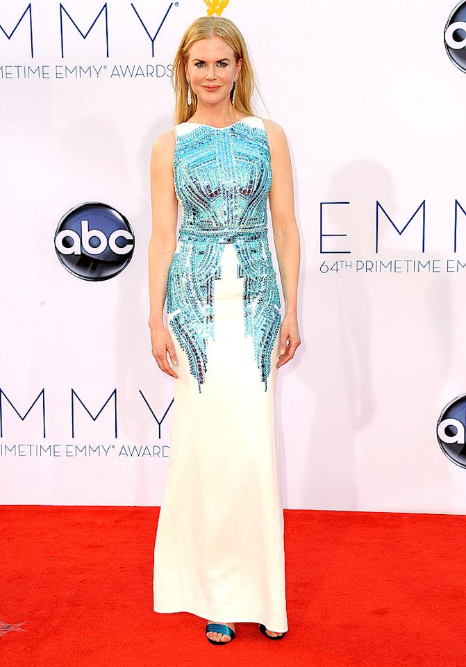 """Nicole Kidman Grade: A Nicole Kidman strutted her movie star style in an Antonio Berardi white column dress featuring blue sequin details on the bodice. The 45-year-old completed her statuesque look with Christian Louboutin heels and a pair of striking diamond-and-jade earrings. On the red carpet, Nicole admitted she was a bit worried about her pale complexion in the hot Los Angeles sun since she's currently shooting a film about the fair-skinned Grace Kelly. """"'I'm going to get in trouble from the director for going back sunburned!"""" she told Ryan Seacrest on her way in."""
