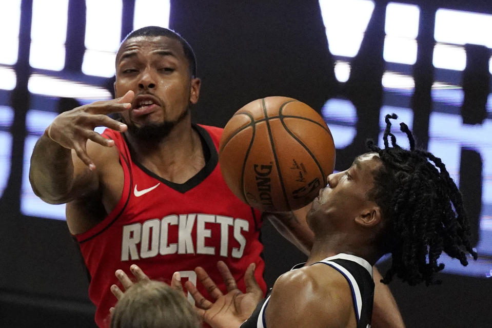 Los Angeles Clippers guard Terance Mann, right, loses control of the ball while under pressure from Houston Rockets forward Sterling Brown during the second half of an NBA basketball game Friday, April 9, 2021, in Los Angeles. The Clippers won 126-109. (AP Photo/Mark J. Terrill)