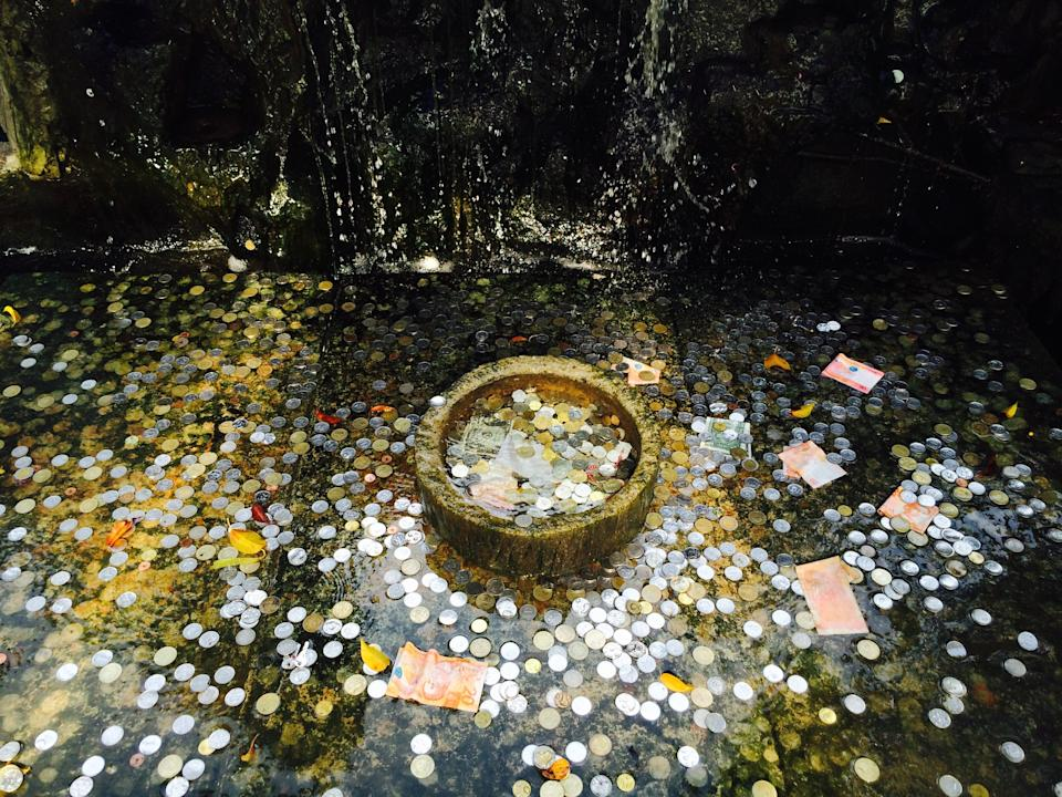 Image of money in a fountain