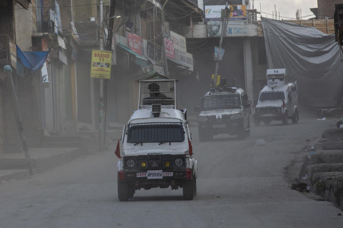 Government forces leave the site of a gunbattle in Shopian, south of Srinagar, Indian controlled Kashmir, Friday, April 9, 2021. Seven suspected militants were killed and four soldiers wounded in two separate gunfights in Indian-controlled Kashmir, officials said Friday, triggering anti-India protests and clashes in the disputed region. (AP Photo/ Dar Yasin)