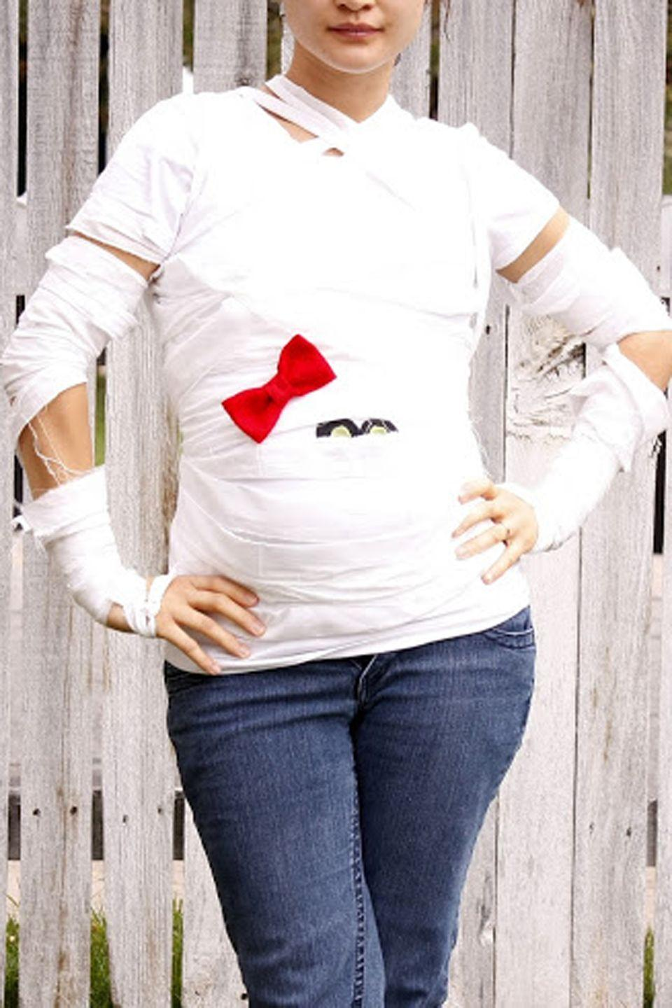 """<p>The perfect costume for a soon-to-be <em>mummy. </em></p><p><strong>Get the tutorial at <a href=""""http://www.deliacreates.com/this-looked-much-better-in-my-head/"""" rel=""""nofollow noopener"""" target=""""_blank"""" data-ylk=""""slk:Delia Creates"""" class=""""link rapid-noclick-resp"""">Delia Creates</a>.</strong></p><p><a class=""""link rapid-noclick-resp"""" href=""""https://www.amazon.com/Crafty-Cuts-2-Yards-Muslin-Fabric/dp/B004FEEXDW?tag=syn-yahoo-20&ascsubtag=%5Bartid%7C10050.g.4972%5Bsrc%7Cyahoo-us"""" rel=""""nofollow noopener"""" target=""""_blank"""" data-ylk=""""slk:SHOP MUSLIN"""">SHOP MUSLIN</a> </p>"""