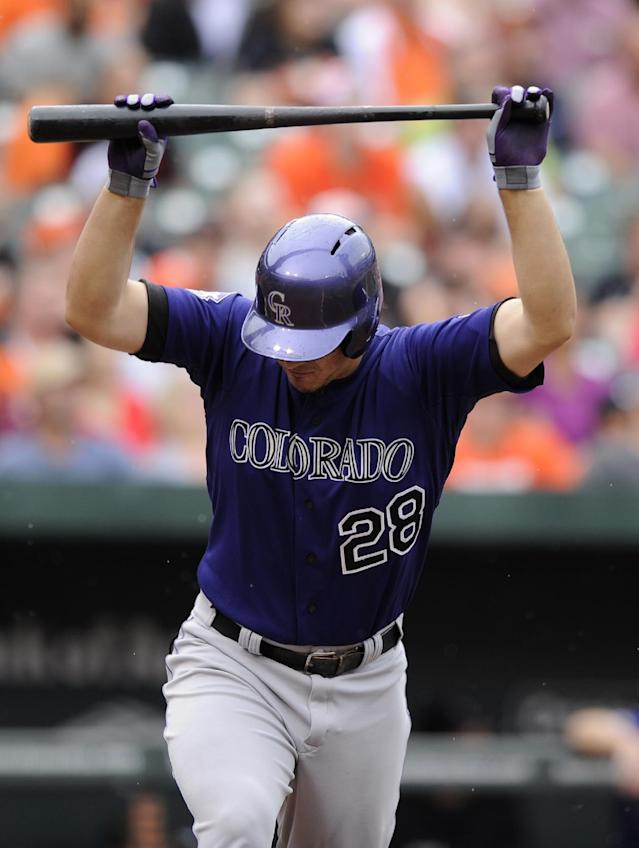 Colorado Rockies' Nolan Arenado reacts after he popped out against the Baltimore Orioles during the fourth inning of a baseball game on Sunday, Aug. 18, 2013, in Baltimore. (AP Photo/Nick Wass)