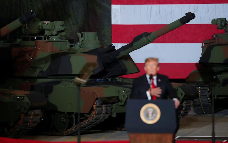 President Donald Trump speaks to workers in front of tanks on display at the Lima Army Tank Plant Joint Systems Manufacturing Center, the country's only remaining tank manufacturing plant, in Lima, Ohio, on March 20, 2019. (Photo: Carlos Barria/Reuters)