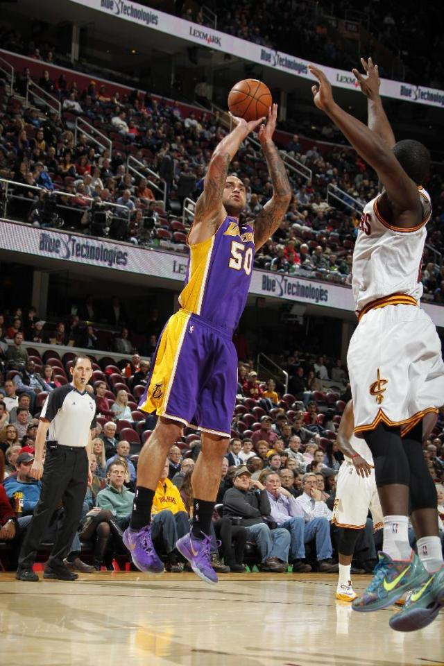 CLEVELAND, OH - FEBRUARY 5: Robert Sacre #50 of the Los Angeles Lakers shoots against the Cleveland Cavaliers at The Quicken Loans Arena on February 5, 2014 in Cleveland, Ohio. (Photo by Gregory Shamus/NBAE via Getty Images)