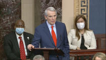 In this image from video, Sen. Rob Portman, R-Ohio, speaks as the Senate reconvenes to debate the objection to confirm the Electoral College Vote from Arizona, after protesters stormed into the U.S. Capitol on Wednesday, Jan. 6, 2021. (Senate Television via AP)
