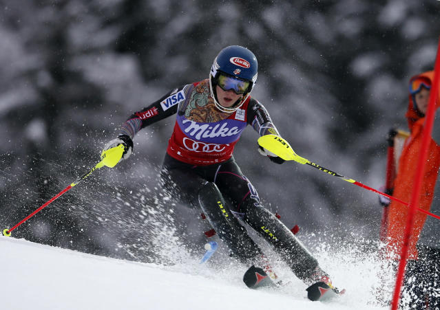 Mikaela Shiffrin, of the United States, speeds past a pole on her way to clock the fastest time during the first run of an alpine ski, women's World Cup slalom, in Bormio, Italy, Sunday, Jan. 5, 2013. (AP Photo/Marco Trovati)
