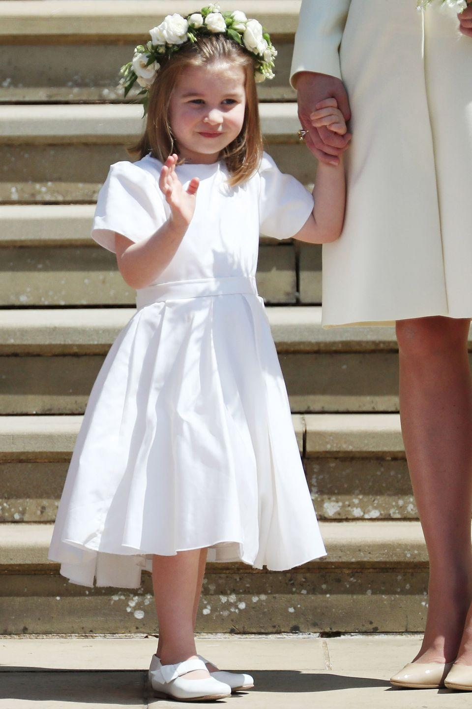 <p>Princess Charlotte makes an appearance in Prince Harry and Meghan Markle's royal wedding party, wearing a white dress and matching floral crown. </p>